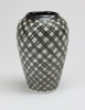 Banksia - carved porcelain with inlaid Tenmoku glaze height 18cm